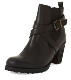 - Real leather- Rounded toe- Cross strap buckle detail- Mid block heel