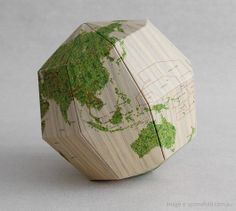 genius paper self assembly globe by geografia that when standing on its own, sits at 23.4 degrees - the exact tilt of the earth's axis!