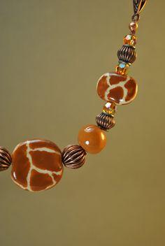 African Kazuri Ceramic Necklace Set with giraffe patterned beaded jungle print. $70.00, via Etsy.
