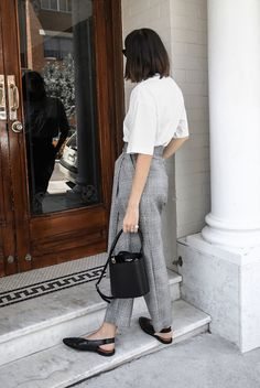 White oversized t-shirt, grey plaid ankle pants, black slingback flats, black bucket bag, black cat eye sunglasses. Spring outfits, casual outfits, fashion trends 2018, casual outfits, work outfits, simple outfits, comfy outfits #fashion2018 #casualstyle #springstyle #streetstyle #ootd #minimaliststyle #fashionblogger #weartowork
