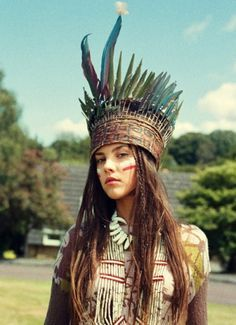 Fashion photography. Tribal shoot. Navajo. Feather crown. White tribal make-up.
