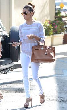 Eva Longoria | skinny white jeans, a sheer top, aviator shades, a tan Birkin, and T-strap heels