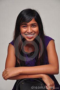 A pretty Sri Lankian girl is smiling.