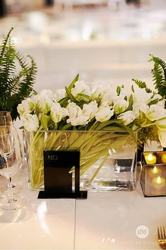 Fresh Cut White Tulip Low Centerpiece | Event Planning & Floral Design: tracytaylordesign... | Photographer: whymanstudios.com | Venue: Perez Art Museum, Florida