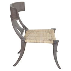 "A curved silhouette delivers the Noir Layton chair surprising sophistication. Tan rattan offers a textured seat, lending its modern form a classic complement. 23.5""W x 29.5""D x 35.5""H; Teak wood with dusk finish"