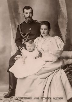 """""""Nicky, Alix and their first baby: Emperor Nicholas II Alexandrovich with his consort Empress Alexandra Fyodorovna and their first-born child Grand Duchess Olga Nikolaevna in a series of formal. Tsar Nicolas, Grand Duchess Olga, House Of Romanov, Alexandra Feodorovna, Historical Women, Victoria And Albert, Queen Victoria, Imperial Russia, Russian Orthodox"""