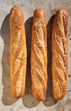 Baguettes at home! When you reduce the length and add steam via ice cubes in a hot cast-iron skillet, it's possible to get good results from your home oven.