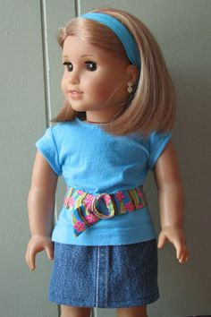 American Girl Doll Clothes / 18 Doll Jean Mini by MadiGraceDesigns - Cute outfit for your American Girl's wardrobe! Trendy aqua top is made from a Liberty Jane pattern and features a coordinating striped belt with pink flowers. The top fastens in the back with a strip of velcro. The skirt is made from upcycled denim and has an elastic waist for easy dressing. Matching aqua headband included!