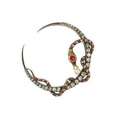 late 19th century diamond, ruby, synthetic ruby, paste and cultured pearl brooch  Modelled a graduated old brilliant-cut diamond crescent with entwined old-cut diamond and vari-cut ruby and synthetic ruby serpent with green paste eyes, and later single cultured pearl accent, mounted in silver and gold, circa 1890  pae gbp1.2-1.5