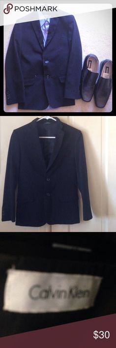 Calvin Klein Jacket Nice Calvin Klein blazer. Notched lapel. Two button closure. Welt pocket on left and flap pockets on hips. Buttons on sleeves.Estimate is boys 12 but can't find size inside. Excellent used condition! Don't know the exact original price but  the current retail price for this type of jacket ( not necessarily the same style but Calvin Klein boys Blazers) is what's listed as the original. Other items pictured are in my closet too so feel free to bundle. Reasonable offers…