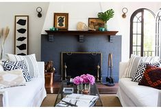 The painted brick fireplace is the focal point of the living room.
