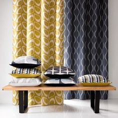 Natasha Marshall - Ikon Print Fabric Collection - Two retro and wavy striped curtains made in mustard yellow and black, with a simple bench and six patterned cushions Retro Curtains, Yellow Curtains, Printed Curtains, Colorful Curtains, Striped Curtains, Hall Curtains, Retro Bedrooms, Retro Living Rooms, Contemporary Cushions
