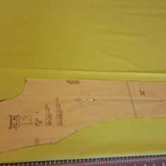 """Cutting out the lining. My client chose lime green. This lab coat is 38.5"""". Cute little coat!"""