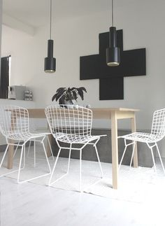 White wire chairs + black lights + art - dining
