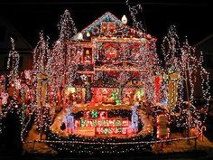 Of all the crazy ways to show your wild side during the holidays—from ridiculously tacky Christmas sweaters to the weirdest White Elephant gifts you can buy—it doesn't get much more extreme than tricking out your house in thousands of colorful Christmas lights. We're not quite sure what motivates these homeowners to indulge in this outlandishly sparkly obsession, (or how they could possibly afford to pay for the out-of-control electric bill that's sure to follow) but one thing's for sure: if…