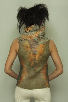 Wow, beautiful work by Lubov Voronina...imagine al the handwork that goes into one vest