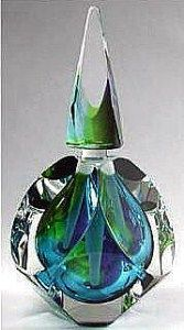 """Jewel Series GlassMaster Paul Harrie, Pacific Perfume Bottle Multifaceted jewel tone, approximately, 6.0""""h x 3.65"""" x 3.45""""."""