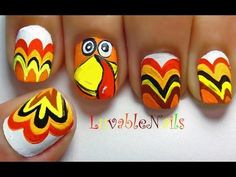 """Gobble! Gobble!"" nail art -- Not wild about the turkey face on the middle nail, looks pretty cheesy to me, but like feathers on the rest of the nails.  Just needs a better turkey face."