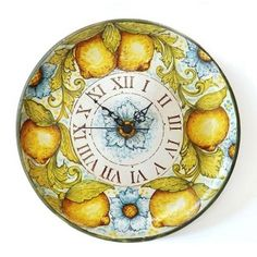 <h3>This Italian wall clock is handmade and nicely hand painted with lemons and flowers by a talented artist from the Scardino family, the owners of Ghenos workshop.</h3><br /> <p>The exquisite beauty of traditional Sicilian pottery inhabits Ghenos' work. Their tiles, wall plates, home decor accents are never ordinary: on the contrary they have the unique quality of high Italian craftsmanship.</p><br /> <p><strong>Product availability</strong>: 3/4 weeks.<br /><strong>Product…