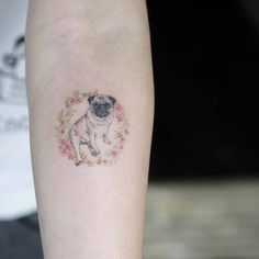 Pug tattoo on the right inner forearm.