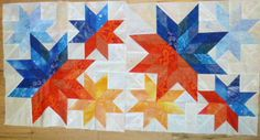 "Meteor Shower, designed by Judy Martin. Pattern is in her book, Scraps. Maker says, ""I have 2 blocks finished and a third about half done. The third one is all blues and oranges as well. The next ones will be pinks and oranges."""