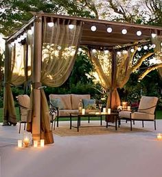 This pergola actually has a retractable canvas roof (can be pulled back or forward in individual sections), as well as closable netting to protect from bugs at night.