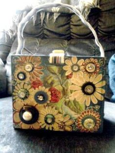 This was a cigar box in another life. Now's it's a quirky purse!