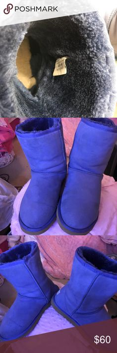 Blue Classic Uggs These are used. Some areas of wear seen at the ankles and at the tops. Not noticeable when wearing and discoloration at the heel when you pull the boot away from the bottom but again not noticeable. These are most likely from me just storing them in my closet and not stuffed and not in a box. The color is a periwinkle or Carolina blue. I love them but they are entirely too big for me. Size 9 no Box. Pictures 3&4 are the true color UGG Shoes Ankle Boots & Booties