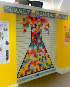 """Summer Reading Club Library Display. This year's theme is """"Fizz Boom Read"""" or more simply Science.  I made a chemistry flask on the wall with electrical tape and we fill it with random shapes that have the children's names on them. Our flask is already overflowing after one day of sign ups!"""