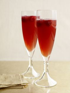 Combine 2 ounces each orange juice and raspberry liqueur (such as chambord) in a cocktail shaker. Fill with ice and shake well. Strain into 2 flutes and top with sparkling rose. Garnish with raspberries.
