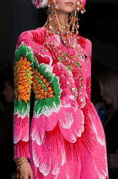 Manish Arora Fall 2014.  Love the asymmetrical design & color pop.