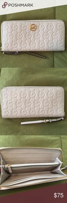 "Michele Kors White Leather zip around White texture leather 100% Leather Zip around Detachable wrist strap 8 cards slots 2 slip pockets Gold Tone logo plaque 8.5""L x 4""H x 1""W Michael Kors Bags Wallets"