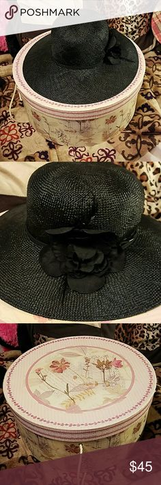 Old hat with hatbox Older fashionable hat with the hatbox included.  Has a black trim with black flower and little feathers coming out from flower.  Made of strong nylon like material not straw. Accessories Hats