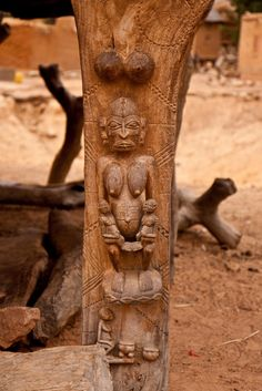 Africa | Animist carvings on the columns of the toguna, the meeting place of the village's council of elders. This one shows the Dogon equivalent of Mother Nature with her male and female offspring.  Dogon country, Mali | ©Mary Newcombe