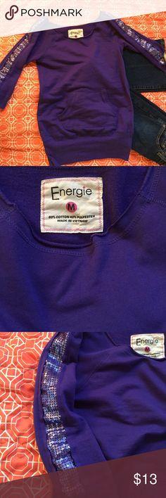 2/$15🦌🌲Purple Sequin sweatshirt Energie, Sz M (definitely a small), purple off the shoulder sweatshirt with sequins along the sleeves, kangaroo pocket, 27in in length Energie Tops Sweatshirts & Hoodies