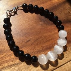 Energy Protection Bracelet This is the ultimate protection bracelet. Both Black Tourmaline and Selenite are wonderful crystals for protection, just have slightly different energy frequencies. Look at