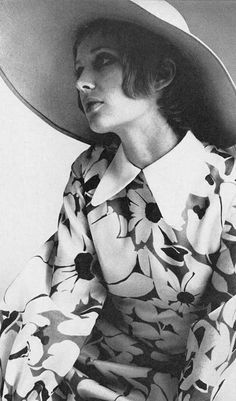 Model wearing a daisy print dress by Christian Dior for Vogue UK, June 1969.