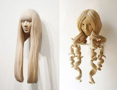 Sculptor Yasuhiro Sakurai carves these stunning wall-mounted sculptures of mysterious women from cypress wood, giving them an almost golden appearance.