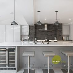 What a kitchen this is, with our Calacatta Vanquish taking centre stage. The end panels on the island have been bookmatched to give a flowing effect. A cool ice bucket sits in the middle of this island which is perfect for this warm weather. A white and grey kitchen featuring all the mod cons.