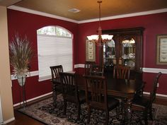 Tempted to paint my dining room this color of burgundy...