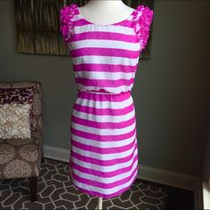 NWOT Lilly Pulitzer Purple Striped Dress NWOT - Lilly Pulitzer - size large - purple / pink and white striped dress - ruffle sleeve detail - fully lined - elastic waist - 37 inches long - polyester material - reasonable offers welcomed - bundle discounts available Lilly Pulitzer Dresses