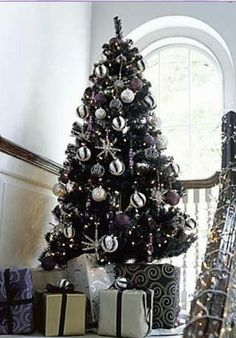 Black Christmas Tree With White, Gray, Silver, And Black Ornaments.