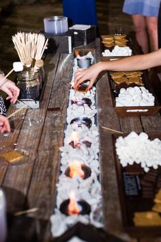 We absolutley love this S'more bar from Royal Fig Catering! What a great way to keep your guests entertained and their bellies full! Captured by Cory Ryan Photography. #Royalfigcatering #coryryanphotography #austinweddings #bridesofaustin