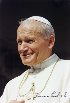 Pope St. John Paul II, please pray for Pope Francis on his first visit to the United States.