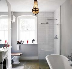 Gray bathroom with white subway tile shower