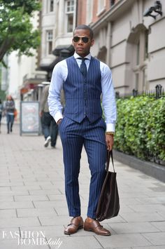 Oooh-kill-em-This-pinstriped-vest-and-pants-combo-is-everything.-Image-by-David-Nyanzi..jpg (614×924)