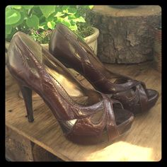 Bakers Krysta Pumps Super cute and retro inspired brown leather pump. 4 inch heel. Slight imperfection on left inner leather (shown in photo). Price has been adjusted accordingly but overall these are in awesome condition. I won't negotiate on this pair simply because I still may wear them. Forgot all about them in my closet! Lol! Bakers Shoes Heels