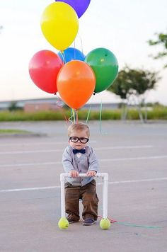 Hipster baby with balloons and walker.
