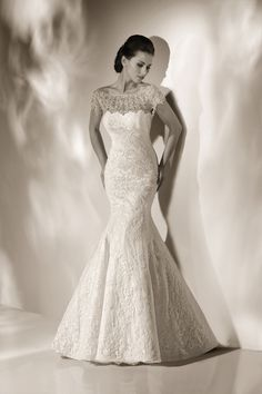 Cristiano Lucci mermaid lace wedding dress with gorgeous illusion neckline detail- try this on in Davenport!