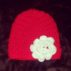 Check out this item in my Etsy shop https://www.etsy.com/listing/481495071/red-crochet-hat-with-white-flower